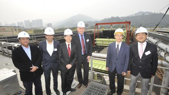 The consortium partners, joined by Mr Wing-cheong Fung (second from right), Senior Electrical & Mechanical Engineer, Electrical & Mechanical Projects Division of the Drainage Services Department, visit the SANI Sewage Treatment Plant at the Shatin Sewage Treatment Works.